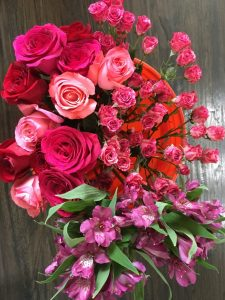 Various pink roses, purple astroemeria & bi-color pink spray roses