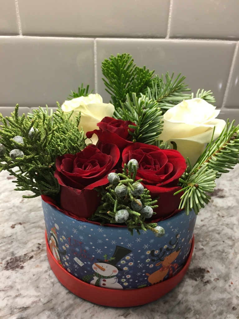 Christmas flowers in a box, red roses, pine, bruni berries