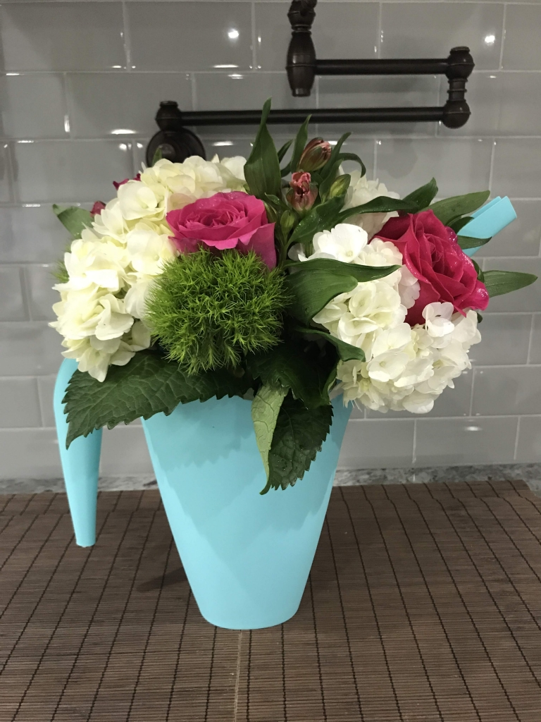 Rustic Farmhouse in a watering can, flowers